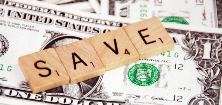 The word save spelled out in scrabble tiles